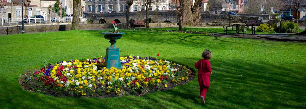 A child plays in the sunshine in Westbury Gardens